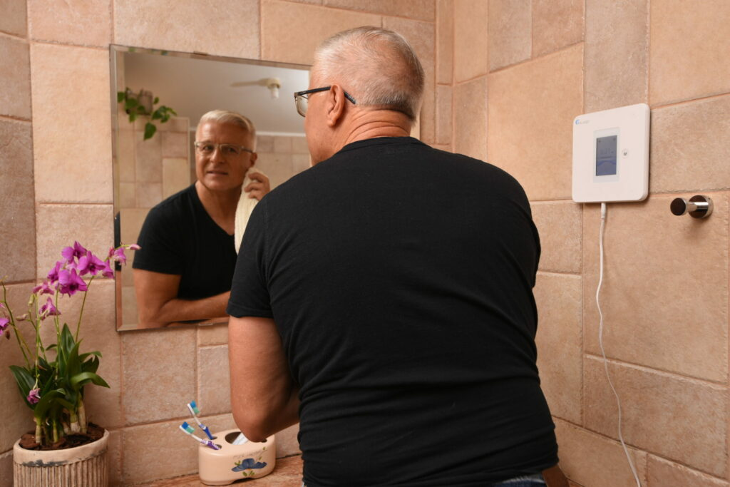 man looking in mirror - fall prevention