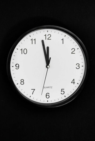clock on black background - fall prevention