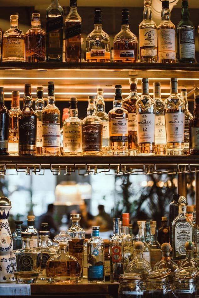 Alcohol bottles on a shelf - fall prevention