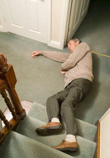 Elderly man fallen over bottom of stairs - Fall prevention